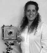 Portrait of Sheri Du Mont with her camera