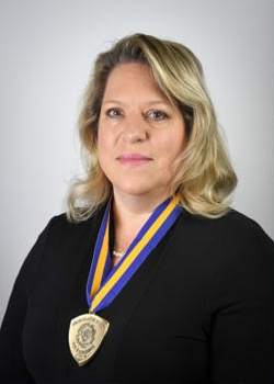 Portrait of Wanda Haby with her Chancellor's Award medal