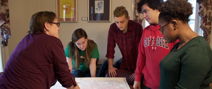 Dr. Wendy Gordon discusses a historical map with students
