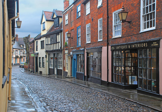 Old-fashioned shops in Norwich on a cobblestone street