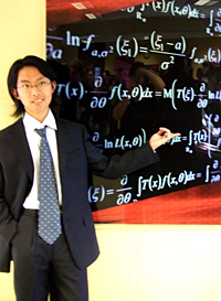 Xiao explains a mathematical equation on the board