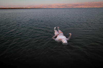 Image of a woman floating on a body of water