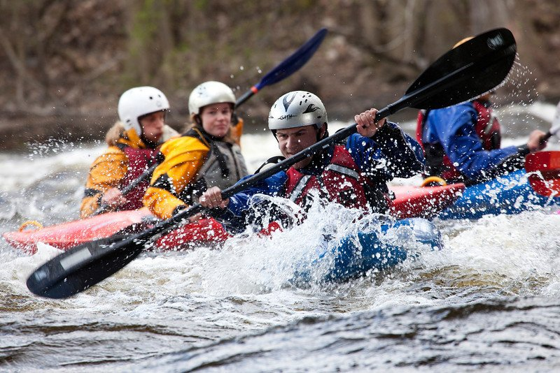 Students kayaking on a river