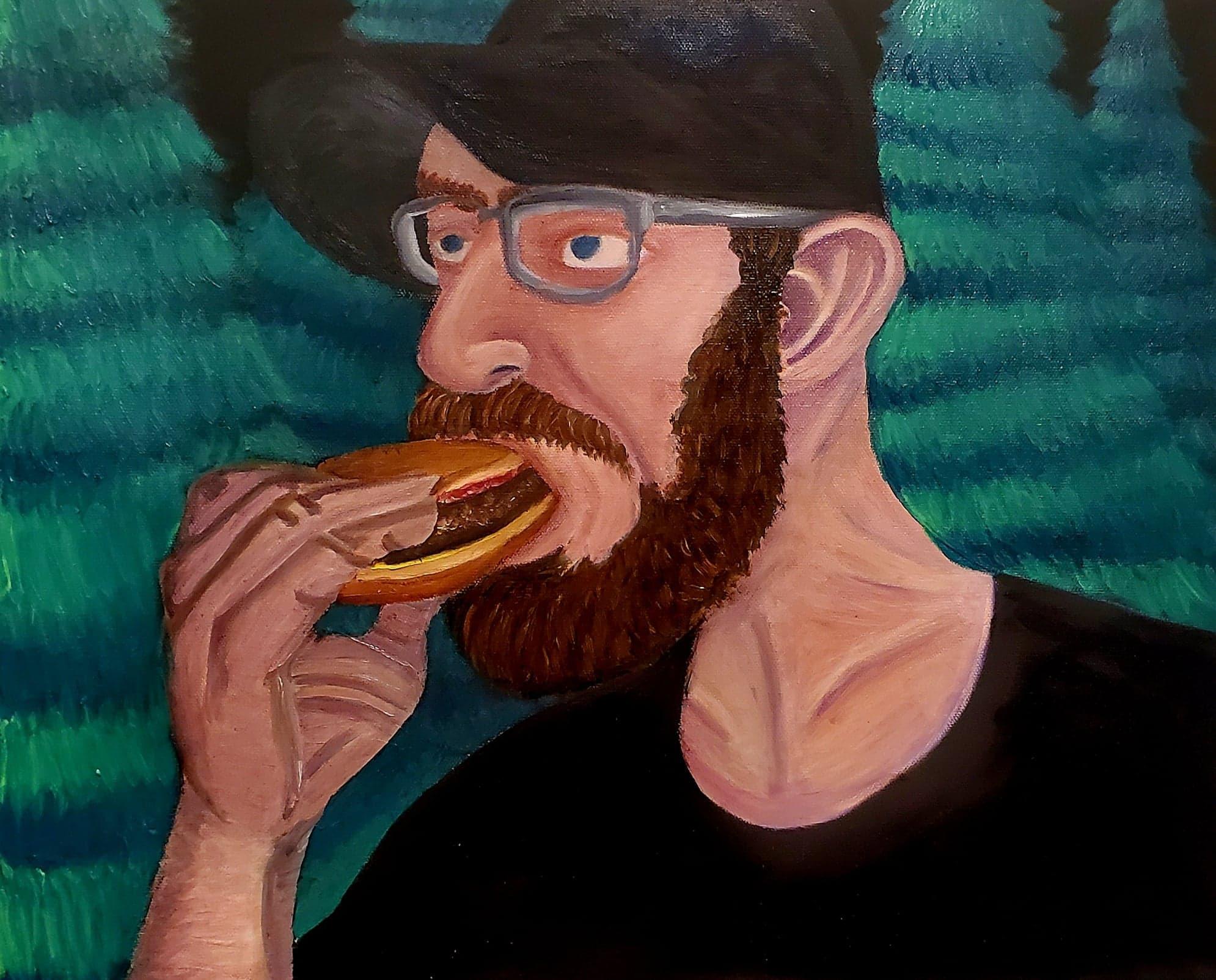 Man eating burger.