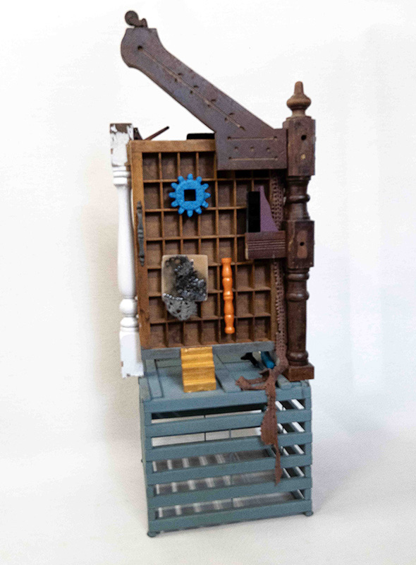 Sculpture incorporating cabinets, some table and pieces, little mechanical parts and crate pieces.