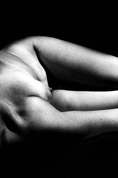 Black & white photo of a female body.