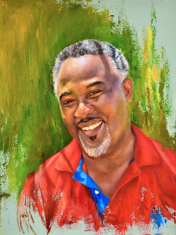 Portrait of an Antiguan man wearing a red and blue shirt. The colors represent parts of the Antiguan flag.
