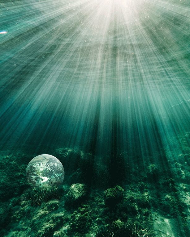 Image of Earth underwater with light shining from above.