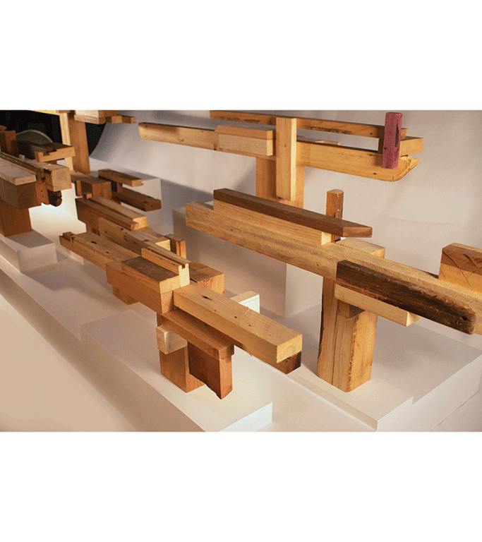 Wood sculpture with planks of wood.