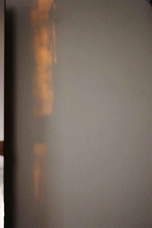 Photo of a wall with a bit of orange natural light on it.