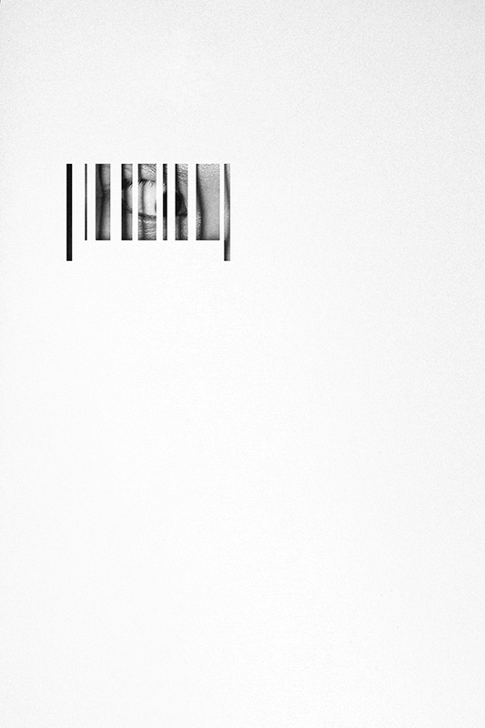 Photo of a person looking through a barcode.