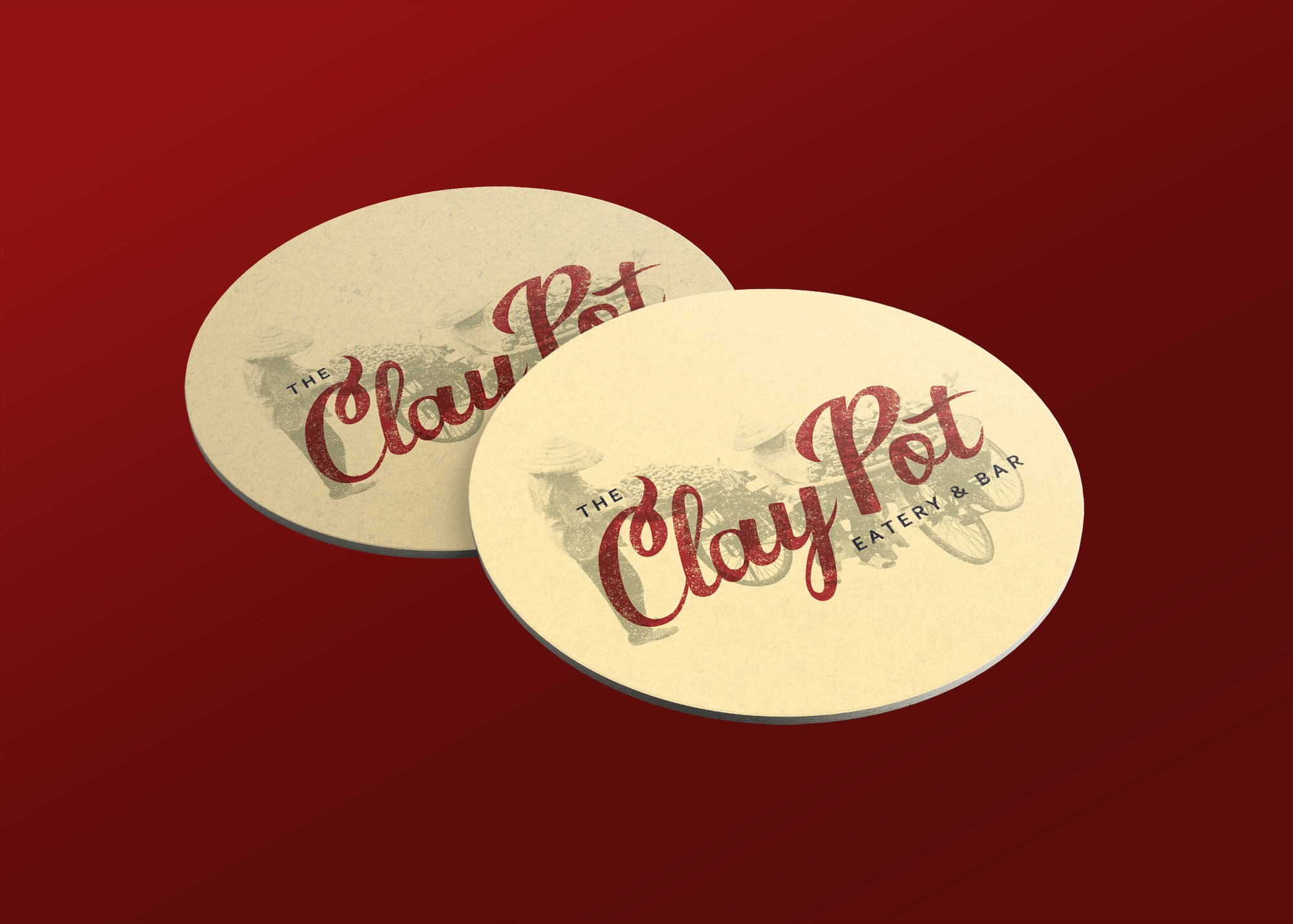 """Designed mockup of cream colored coasters that say """"Clay Pot."""""""