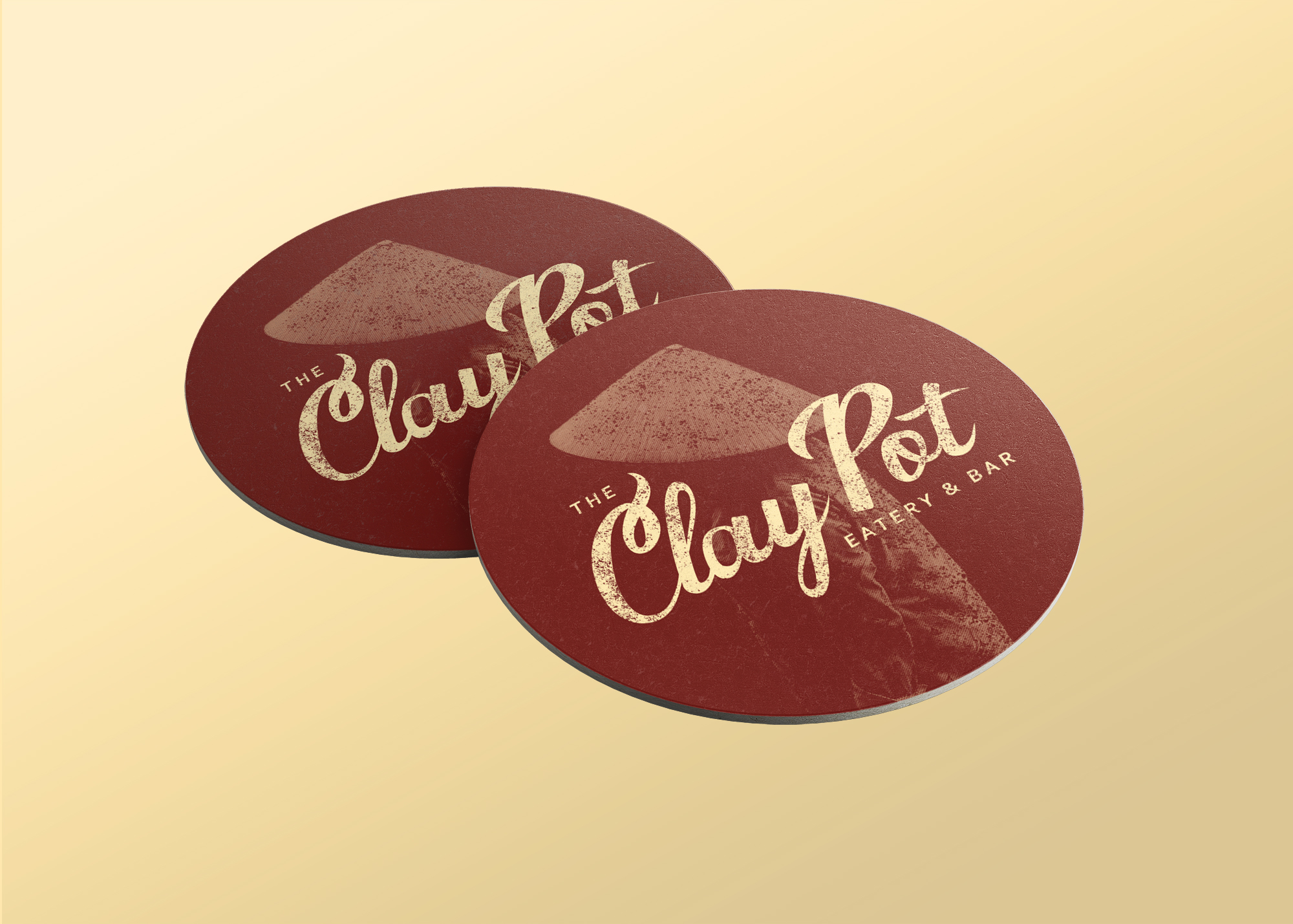 """Designed mockup of chocolate colored coasters that say """"Clay Pot."""""""