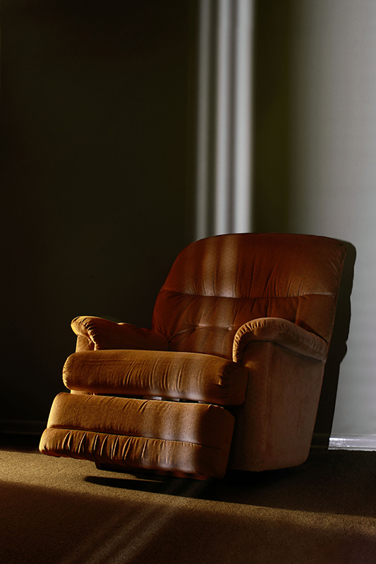 Photo of a brown recliner.
