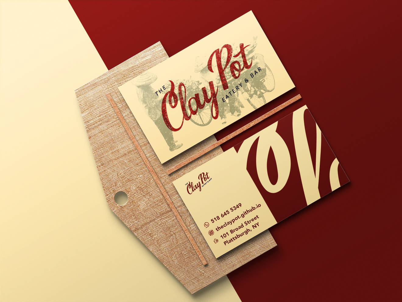 """Design Mockup of a """"Clay Pot"""" business card on a card holder."""