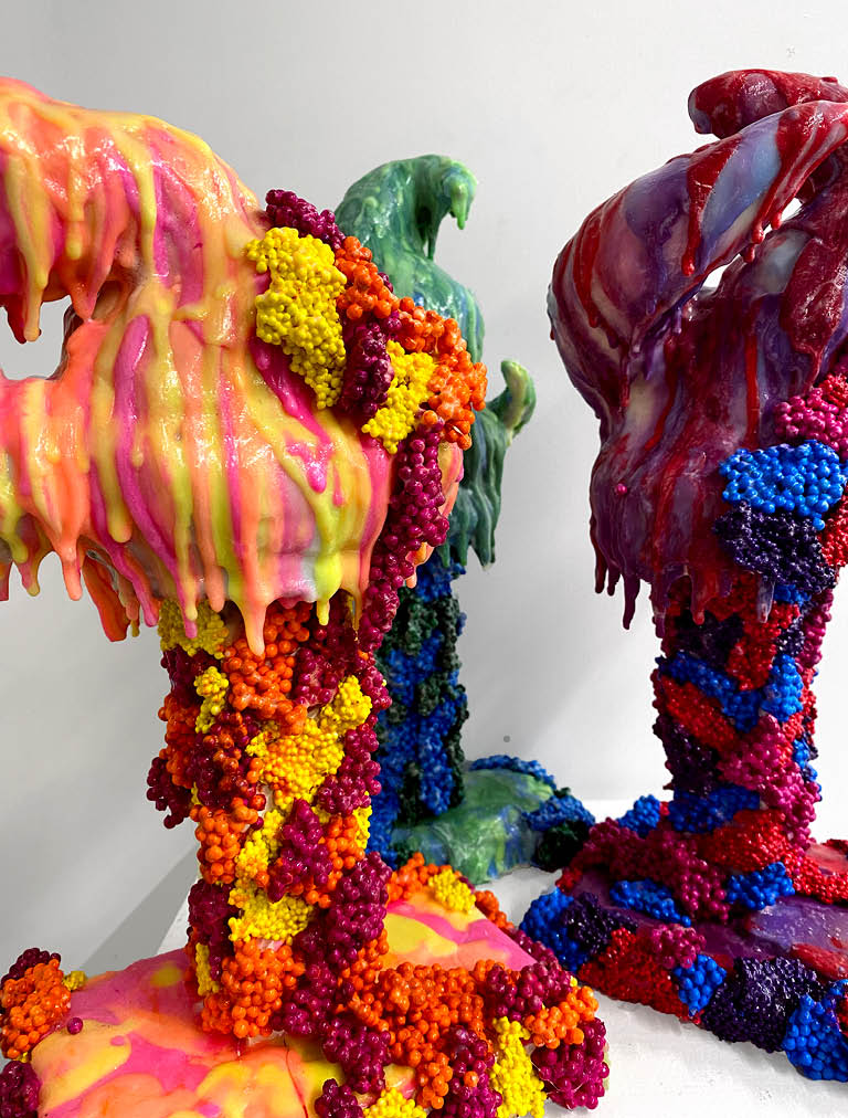 Multi-color sculpture with mixed media.