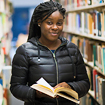 Photo of students hold a book in Feinberg Library