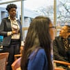 Photo of EOP alumni speaking with students