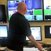 Photo of studio manager Jon Chew working in one of the control booths at SUNY Plattsburgh TV studio