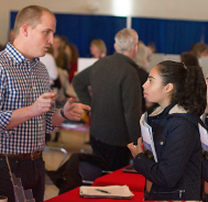 Photo of Admissions staff talking to student