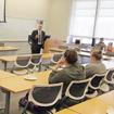 Photo of Ed Tavino '87 meeting with SUNY Plattsburgh students.