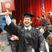 Photo of SUNY Plattsburgh students celebrating commencement
