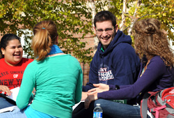 Photos of students talking outside on campus