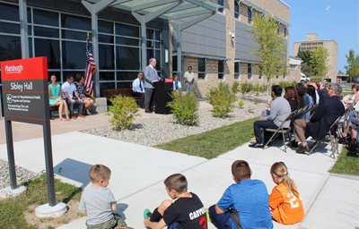 Photo of Dr. John Ettling making remarks to visitors at the grand opening of the center's new location