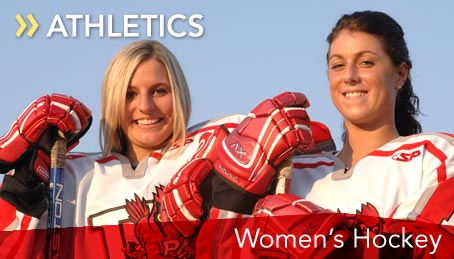 Photo of two women's hockey team players