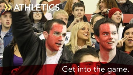 Super fans with painted faces cheering on the hockey team. This link opens a new browser window that will take you to the SUNY Plattsburgh Cardinal Sports homepage.