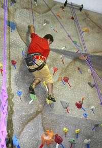 Photo of SUNY Plattsburgh student climbing the wall