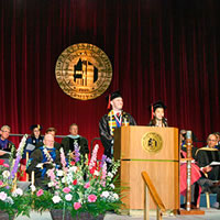 Photo of SUNY Plattsburgh students speaking at commencement ceremony
