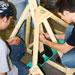 Photo of SUNY Plattsburgh students building a trebuchet