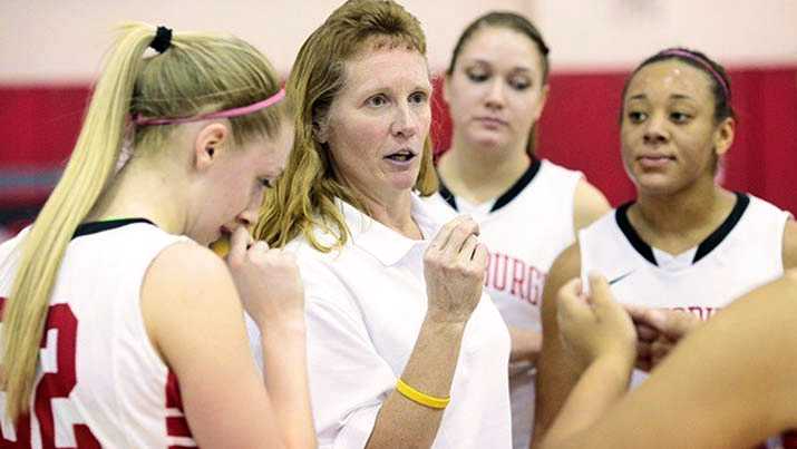 Photo of Coach Cole and the Women's Basketball Team