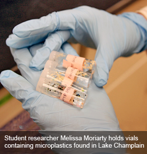 Student researcher Melissa Moriarty holds vials containing microplastics found in Lake Champlain as part of research she is doing under the tutelage of Dr. Danielle Garneau, associate professor in the Center for Earth and Environmental Science.