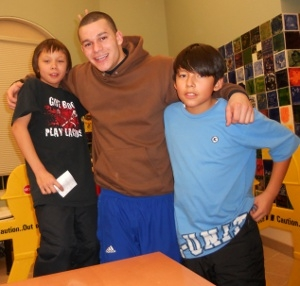 Photo of SUNY Plattsburgh student mentoring children as part of Alternative Spring Break