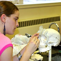 Photo of Anna Brost in the forensic anthropology lab