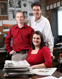 Photo of students and their advisor in the Cardinal Points office