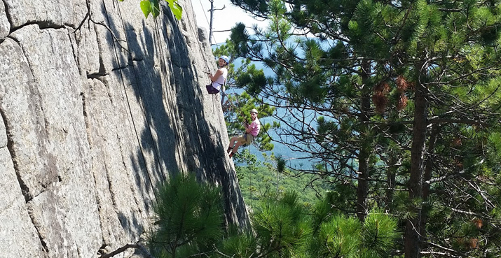 Photo of SUNY Plattsburgh students rock climbing as part of their Odyssey Freshman Adventure orientation