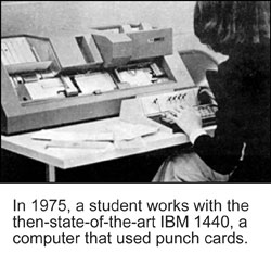 Photo of a student working on 1975 IBM 1440, a computer that used punch cards.