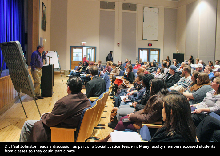 Photo shows Dr. Paul Johnson speaking in Giltz Hall.