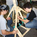 Photo of SUNY Plattsburgh stduents building a working trebuchet