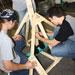 Photo of SUNY Plattsburgh stduents building a working trebuchet