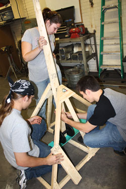 Photo of SUNY Plattsburgh students building a working trebuchet