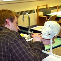 Photo of Ryan McCalla in the forensic anthropology lab