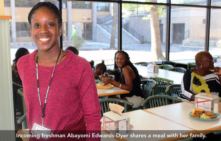 Photo of incoming freshman Abayomi Edwards-Dyer having a meal with her parents in Clinton Dining Hall
