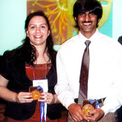 Photo of Melissa Kopp and Nishank Bhalla holding 2007 Sigma Xi Student Research Conference award medals