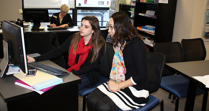 Photo of SUNY Plattsburgh students accessing CardinalConnect from the Career Development Center office.