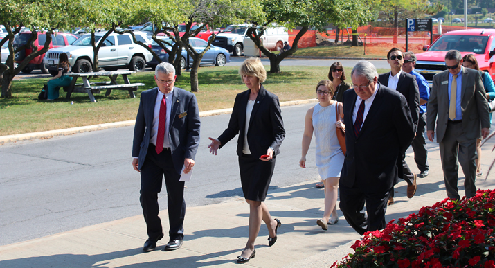 Photo of new Chancellor Kristina Johnson touring the campus