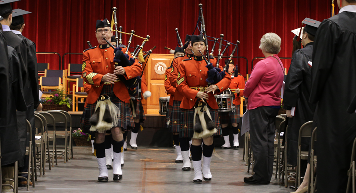 Photo of pipers marching at commencement